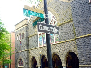Portland Humor: that is a the face of Christopher Walken on that ONE WAY sign. On a side note, check out that stained glass.