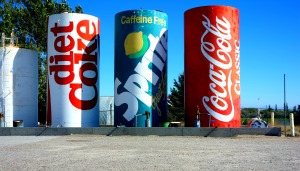 A gas station in Osgood, WY had these beautifully painted popcans. I just kept wondering about the dentist bill for the person who claims these cans.