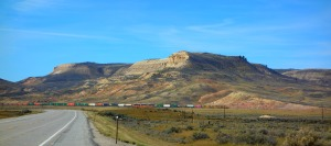 One of those lovely Montana buttes. This was on Highway 15, on the way from Pocatello, Idaho to Missoula.  It looks like a colored pencil drawing, and the colorful train just makes the mountain that much more unreal.